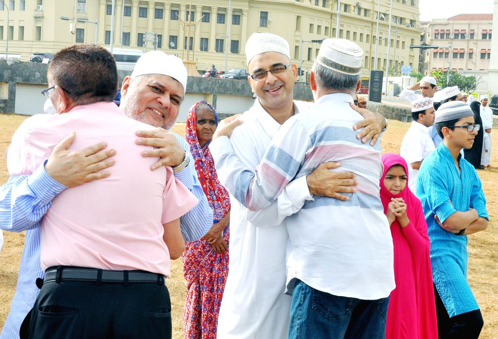 COLOMBO, July 6, 2016 - Sri Lankan Muslims greet each other after the Eid Al-Fitr prayer at Galle Face Green in Colombo, Sri Lanka, July 6, 2016.