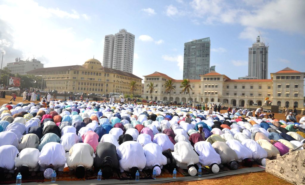 COLOMBO, July 6, 2016 - Sri Lankan Muslims offer prayers on the first day of the Eid al-Fitr festival at Galle Face Green in Colombo, Sri Lanka, July 6, 2016.