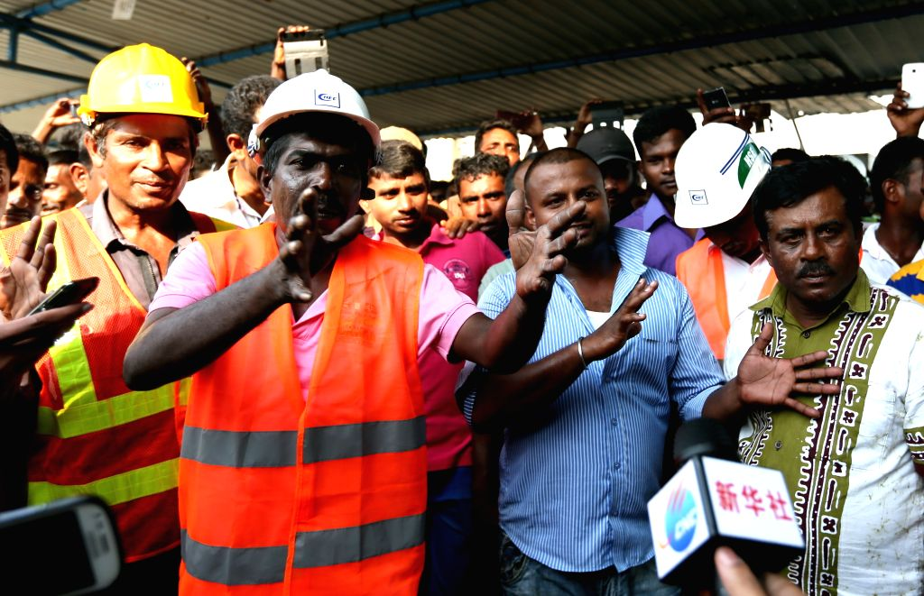 Workers of the project speak to media in Colombo, Sri Lanka, March 9, 2015. A port city project in the capital Colombo was temporarily suspended by the new Sri ...