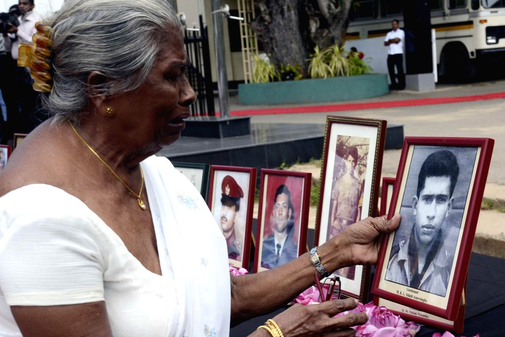 A woman mourns at a ceremony marking Sri Lanka's D.S. Senanayake College's 20th Annual Ranaviru Day at the college premises in Colombo, Sri Lanka, March 19, 2015. ...