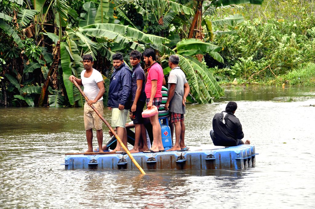 COLOMBO, May 16, 2016 - People take boat as the road was cut off from minor floods in Colombo, Sri Lanka, May 16, 2016. Several roads in the country have been cut off from minor floods and fallen ...