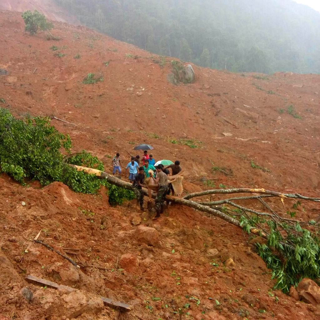 COLOMBO, May 18, 2016 - Military personnel and members of rescue teams search for survivors in Kegalle District, Sri Lanka, May 18, 2016. The death toll from a landslide in Sri Lanka's Kegalle ...