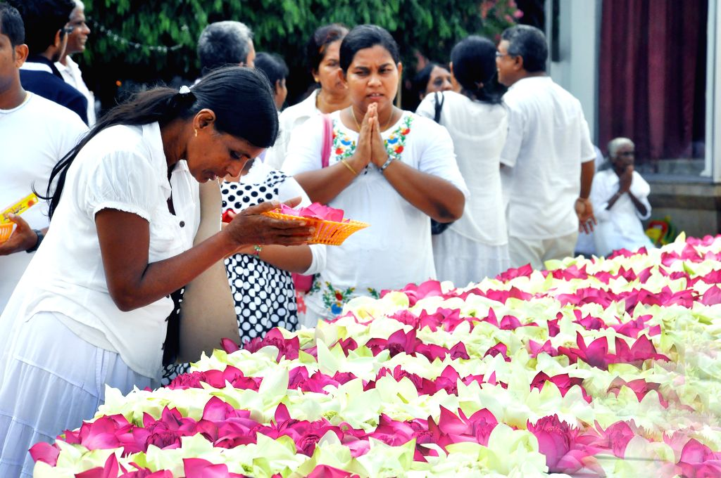 COLOMBO, May 21, 2016 - Sri Lankan people pray for those affected by floods and landslides at the Gangarama Temple on the Vesak Day in Colombo, Sri Lanka, May 21, 2016. Vesak celebrations have been ...