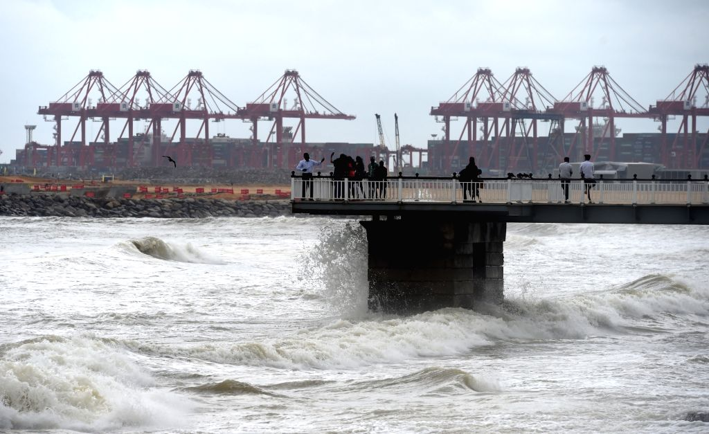 COLOMBO, May 22, 2018 - Local residents watch the strong tides during a weather of heavy rains and strong winds in Colombo, Sri Lanka, on May 21, 2018. The death toll from high winds and rains which ...