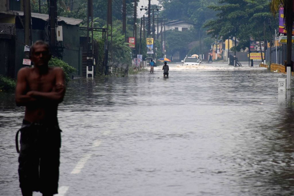 COLOMBO, May 23, 2018 - People wade through water in suburban areas of Colombo, Sri Lanka, on May 23, 2018. The death toll from high winds and rains which lashed out across Sri Lanka since Saturday ...