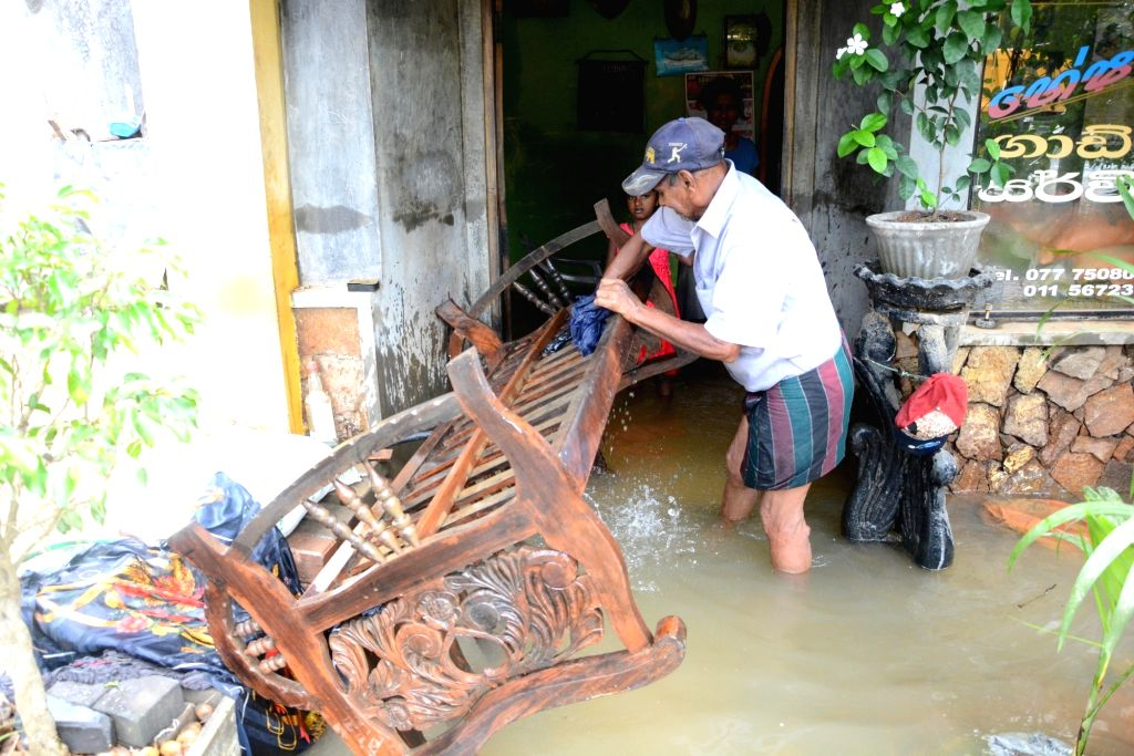 COLOMBO, May 30, 2017 - A man salvages furniture from his flooded home in Kaduwela, Sri Lanka, on May 29, 2017. Sri Lanka on Tuesday said that it was preparing to face health concerns once the floods ...
