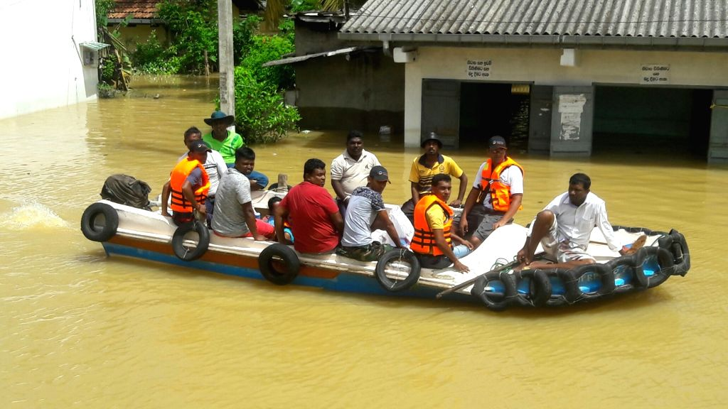 COLOMBO, May 30, 2017 - People evacuate from a flood-affected area in Hitthatiya Matara district of Sri Lanka on May 30, 2017. The number of deaths reported in floods and landslides has increased to ...