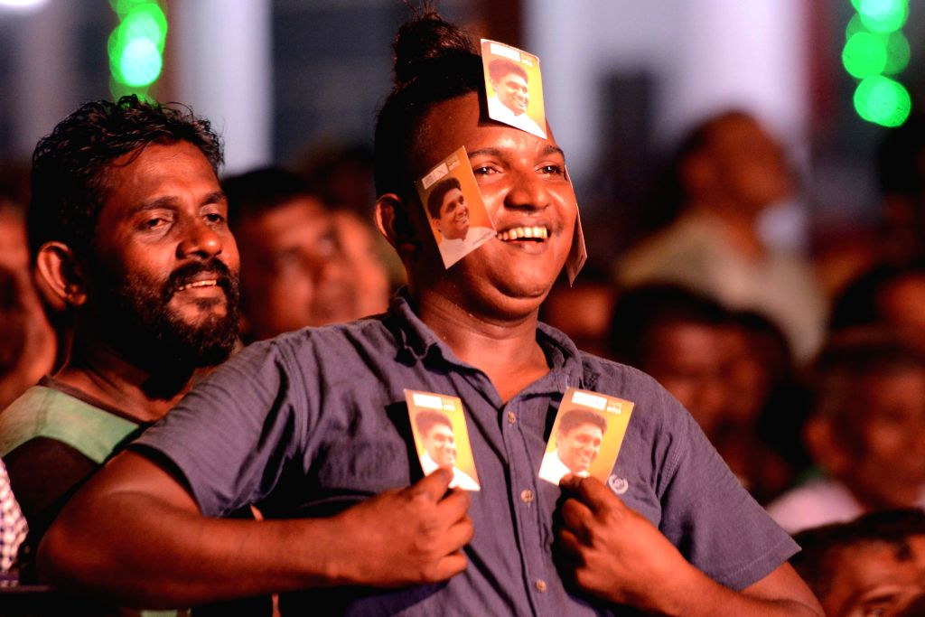 COLOMBO, Nov. 13, 2019 - Supporters of the ruling United National Front presidential candidate Sajith Premadasa attend a final campaign rally in Colombo, Sri Lanka, on Nov. 13, 2019. The presidential ...