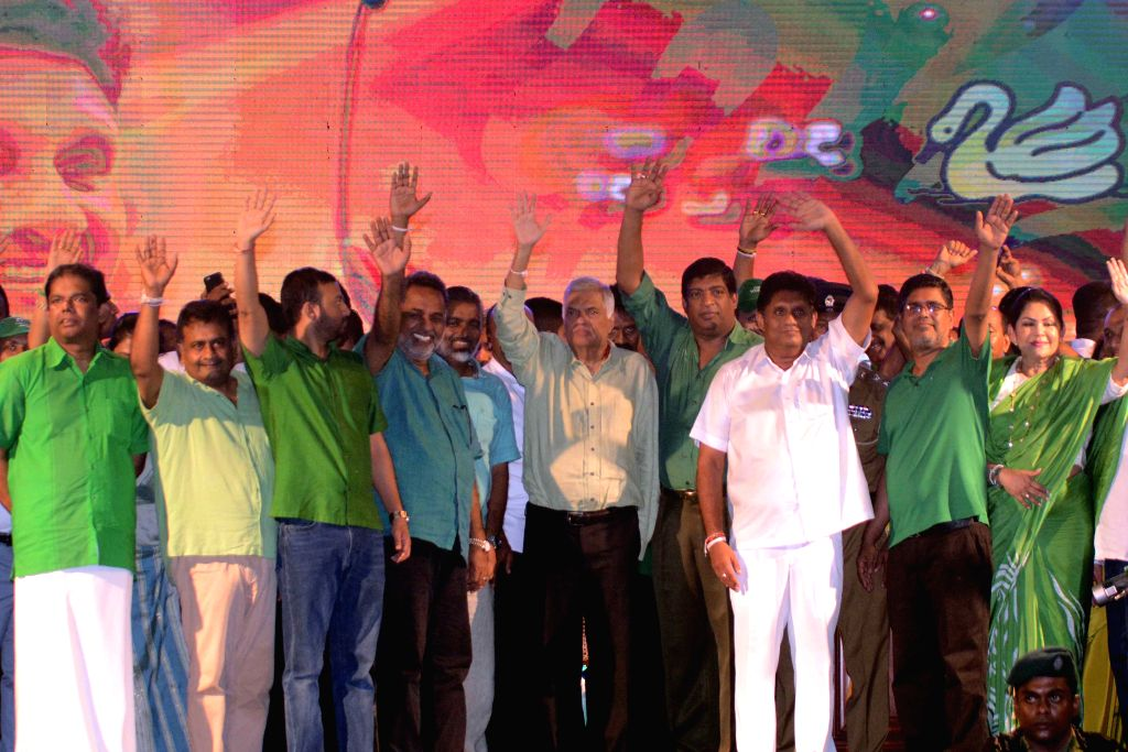 COLOMBO, Nov. 13, 2019 - The ruling United National Front presidential candidate Sajith Premadasa (3rd R) attends a final campaign rally in Colombo, Sri Lanka, on Nov. 13, 2019. The presidential ...