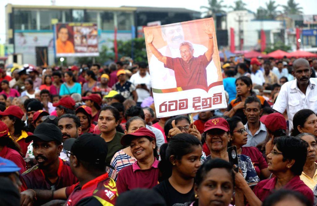 COLOMBO, Nov. 13, 2019 (Xinhua) -- Supporters of Gotabaya Rajapaksa, Sri Lanka's presidential candidate of the main opposition Sri Lanka Podujana Peramuna (SLPP), attend a final campaign rally in Homagama, outskirts of Colombo, Sri Lanka, on Nov. 13,