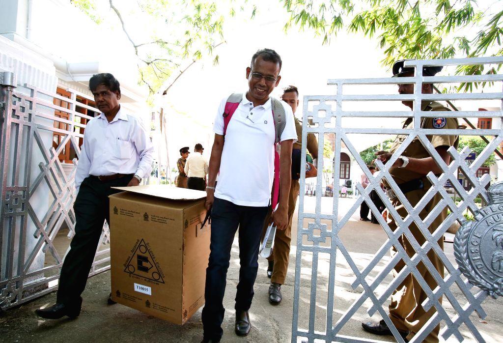 COLOMBO, Nov. 15, 2019 - Officials of Sri Lanka's Elections Commission and police officers prepare to distribute ballot boxes to voting centers in Colombo, Sri Lanka, Nov. 15, 2019. A total of 35 ...