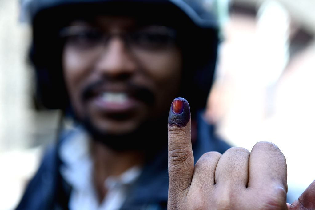 COLOMBO, Nov. 16, 2019 - A man shows his finger after casting his ballot during the presidential elections in Colombo, Sri Lanka, Nov. 16, 2019. The voter turnout in Sri Lanka's presidential ...