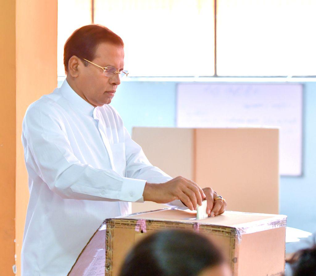 COLOMBO, Nov. 16, 2019 - Sri Lankan President Maithripala Sirisena casts his ballot at a polling station in Polonnaruwa, Sri Lanka, Nov. 16, 2019. The voter turnout in Sri Lanka's presidential ...