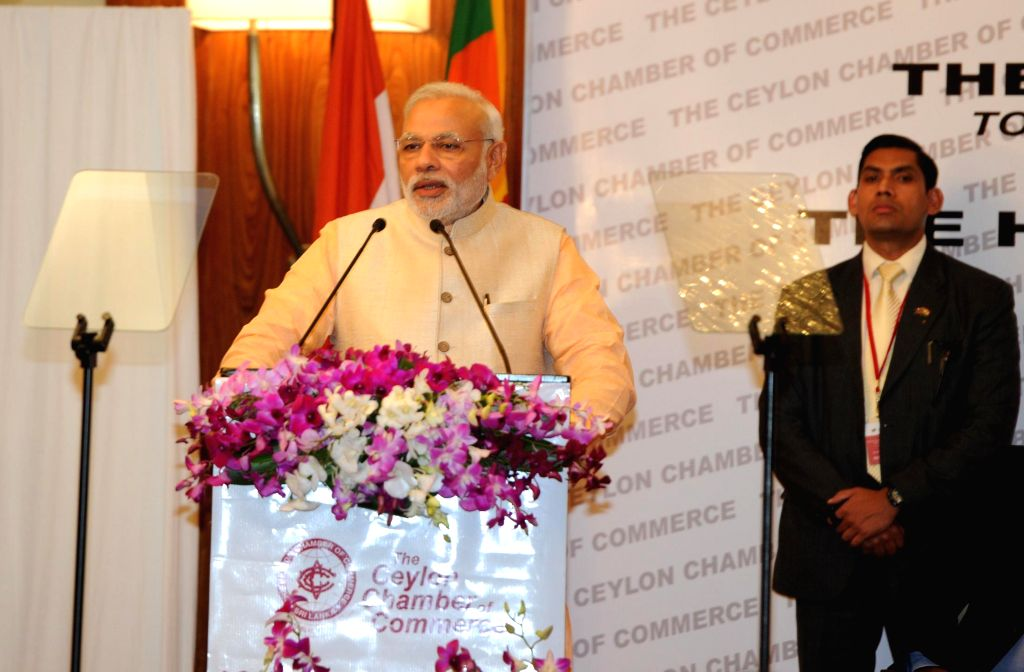 Prime Minister Narendra Modi addresses the business meeting hosted by the Ceylon Chamber of Commerce, in Colombo, Sri Lanka on March 13, 2015. - Narendra Modi