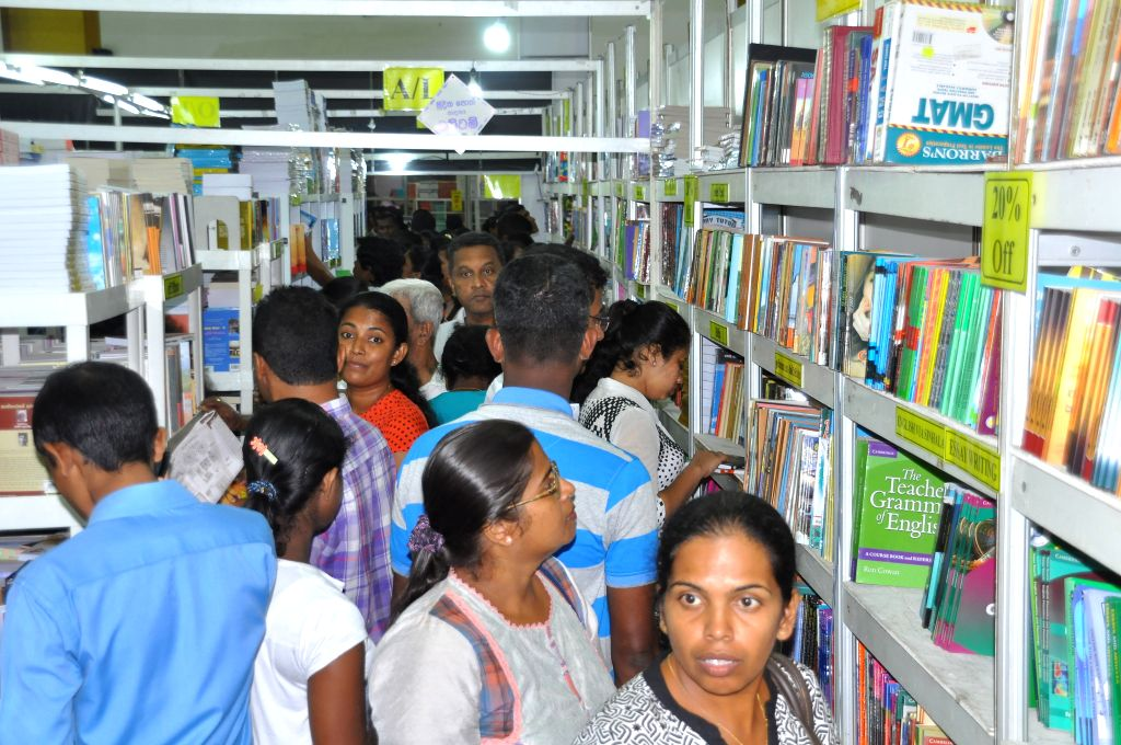 COLOMBO, Sept. 17, 2016 (Xinhua) -- Sri Lankan people read and choose books at the 18th Colombo International Book Fair in Colombo, capital of Sri lanka, Sept. 16, 2016. The annual Colombo International Book Fair, kicked off in the capital on Friday,