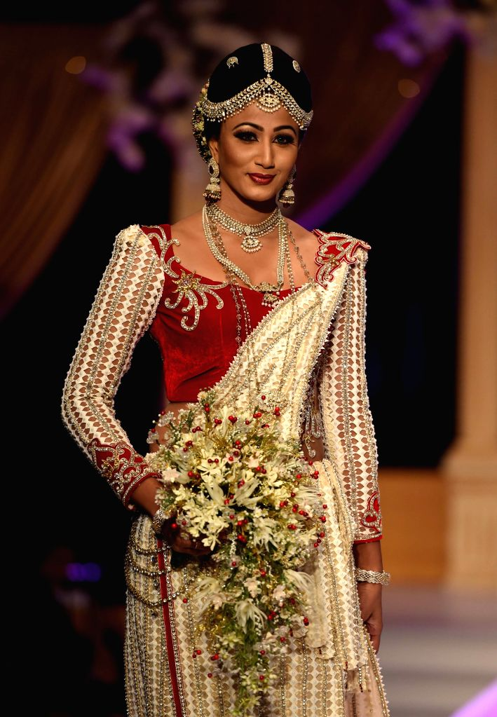 "COLOMBO, Sept. 19, 2016 - A Sri Lankan model presents a creation by local designer during the ""Brides of Sri Lanka"" Bridal show event in Colombo, capital of Sri Lanka, Sept. 18, 2016. The ..."