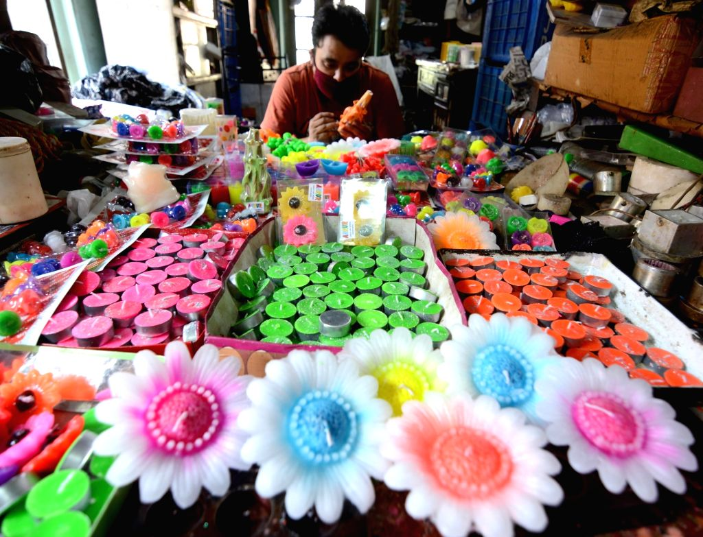 Colorful candles being prepared at a workshop on the eve of Diwali, in Kolkata on Nov 13, 2020.