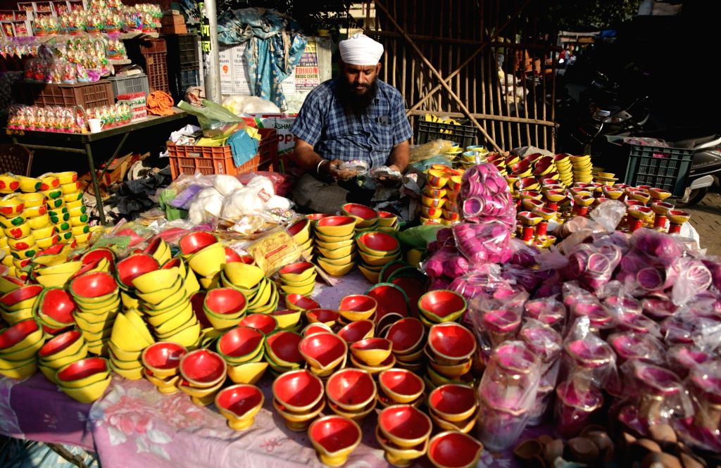 Colorful earthen lamps being sold on the eve of Diwali in Amritsar on Oct 26, 2019.