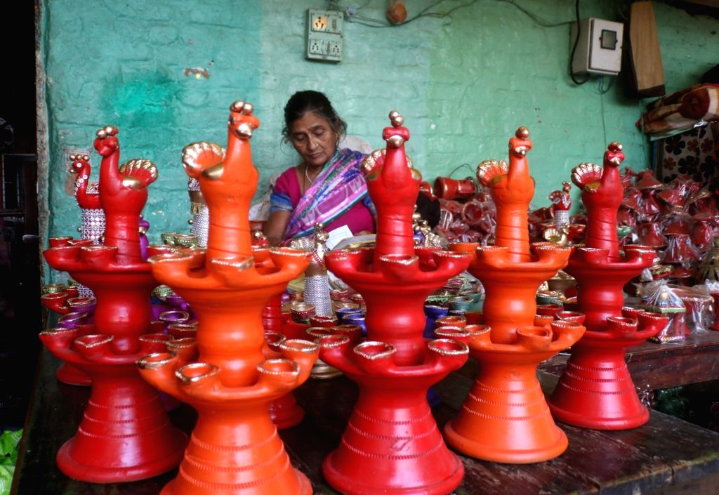 Colorful earthen lamps on sale ahead of Diwali celebrations, in New Delhi on Oct 18, 2019.