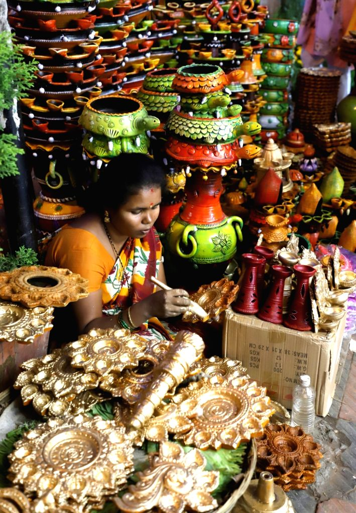 Colorful earthen lamps or 'diyas' on sale  at a market ahead of Diwali celebrations, in Bengaluru on Oct 25, 2019.