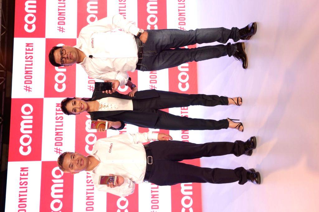 Comio CEO Sanjay Kalirona along with actress Yami Gautam at the launch of Comio smartphone in New Delhi, on August 18, 2017. - Yami Gautam