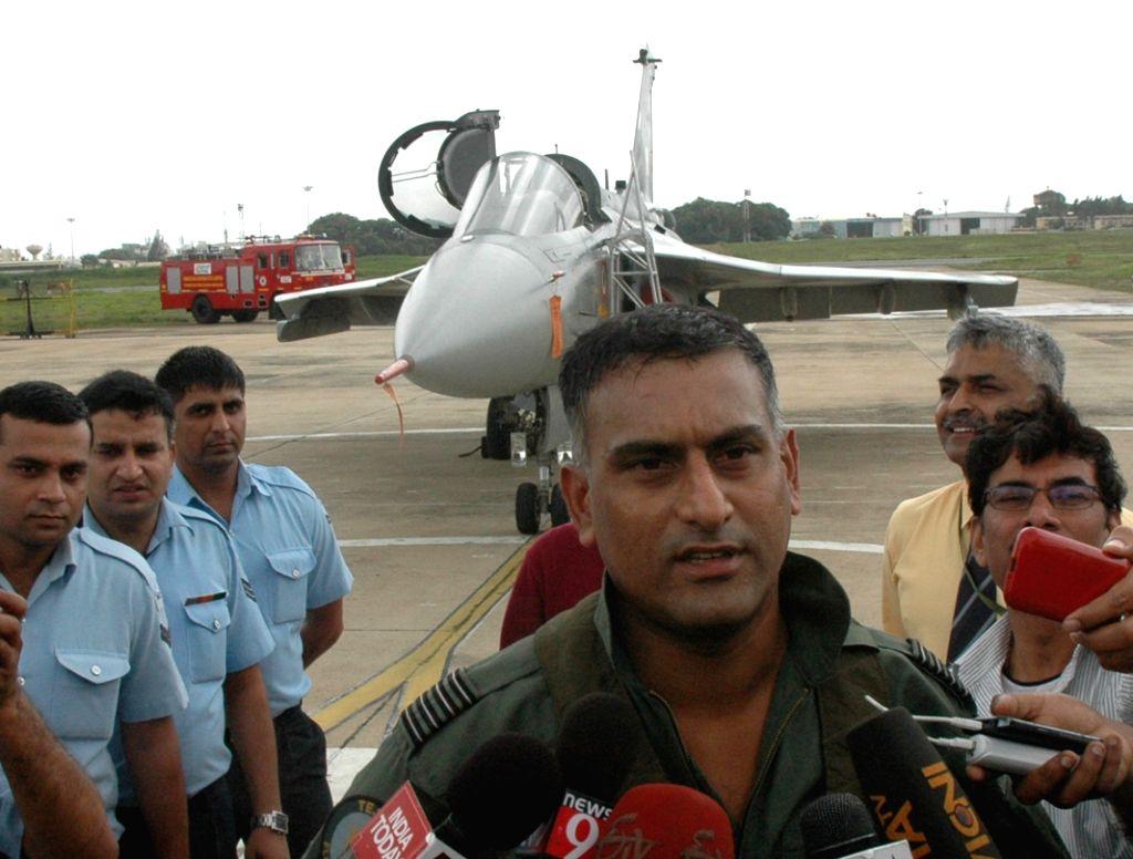 Commanding officer Captain Madhav Rangachari talks to press after flying Tejas Light Combat Aircraft (LCA) during its induction ceremony at HAL, in Bengaluru on July 1, 2016. - Madhav Rangachari