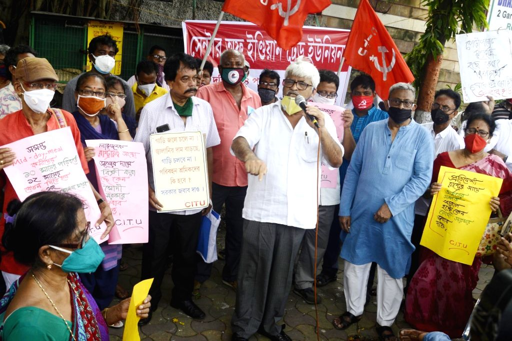 Communist Party of India-Marxist (CPI-M) leader Sujan Chakraborty along with with others activists participate in a cycle rally to protest against hike in the prices of petrol and diesel, in ... - Sujan Chakraborty