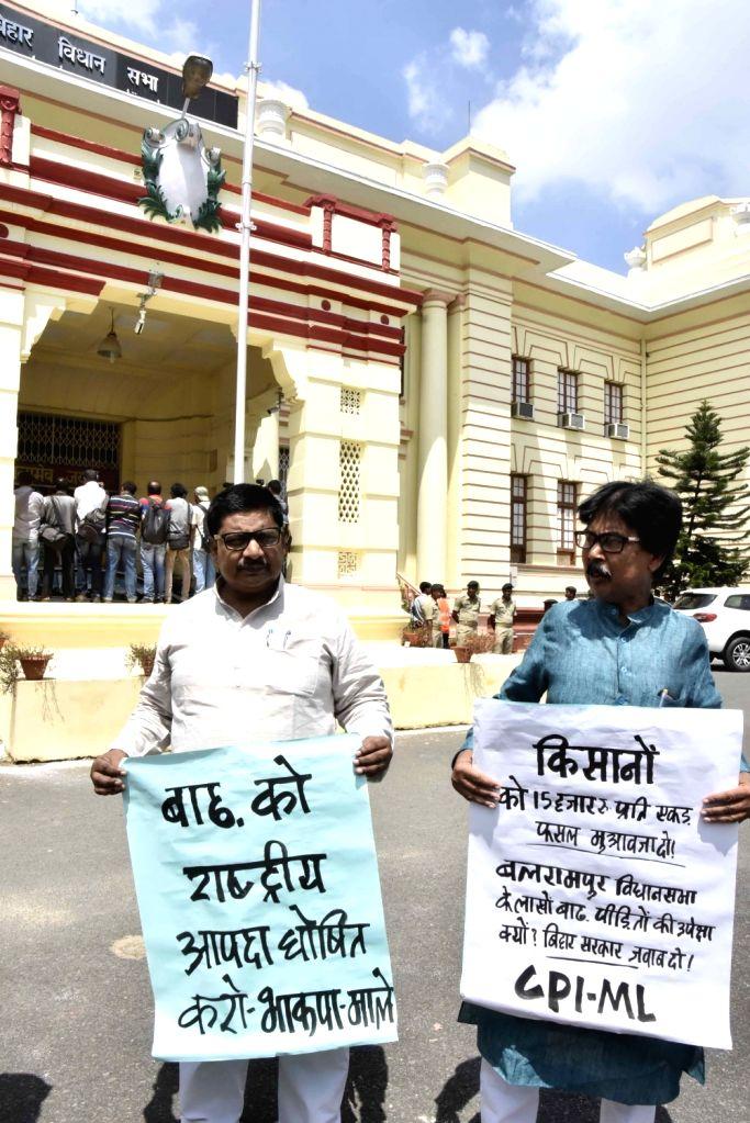 Communist Party of India Marxist–Leninist (CPI-ML) legislators stage a demonstration against Nitish Kumar at Bihar Legislative Assembly in Patna on Aug 21, 2017. - Nitish Kumar