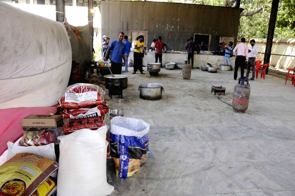 Community kitchen organised at a school to serve the food requirements of the poor, needy and homeless on Day 6 of the 21-day nationwide lockdown imposed to contain the spread of coronavirus, ...