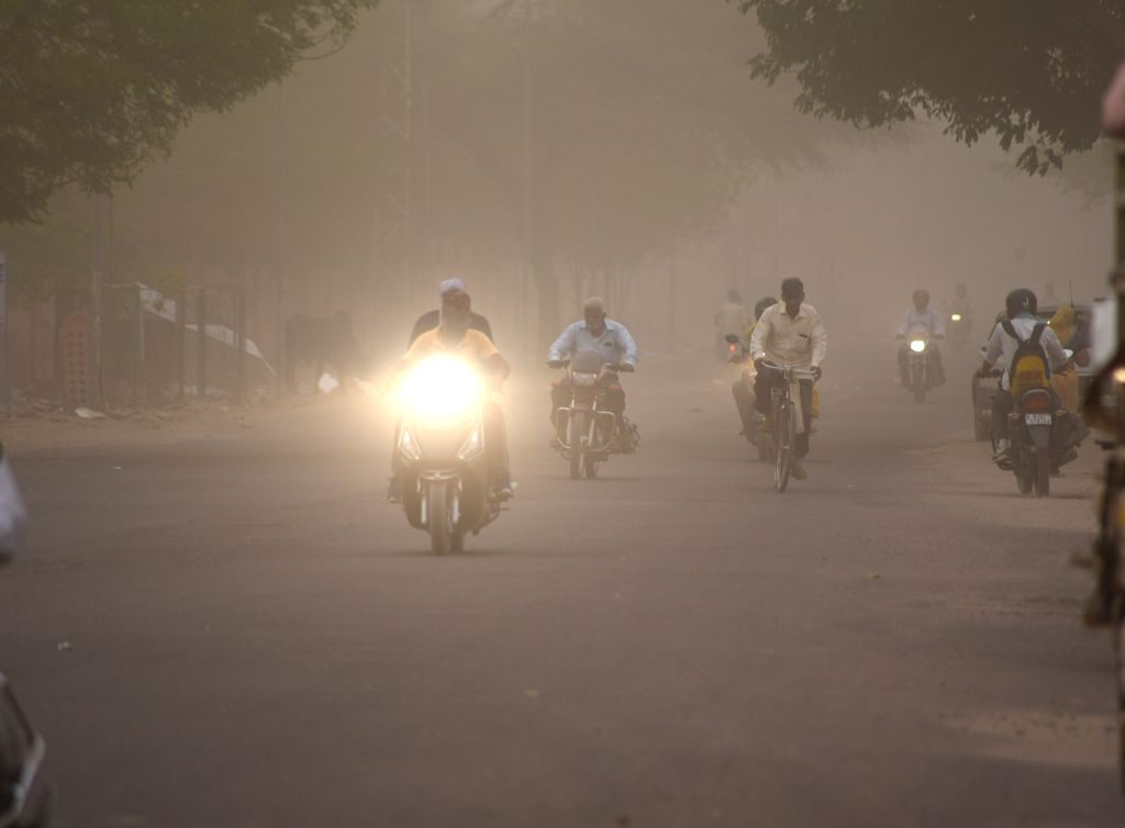 Commuters during a dust storm, in Bikaner on May 30, 2018.