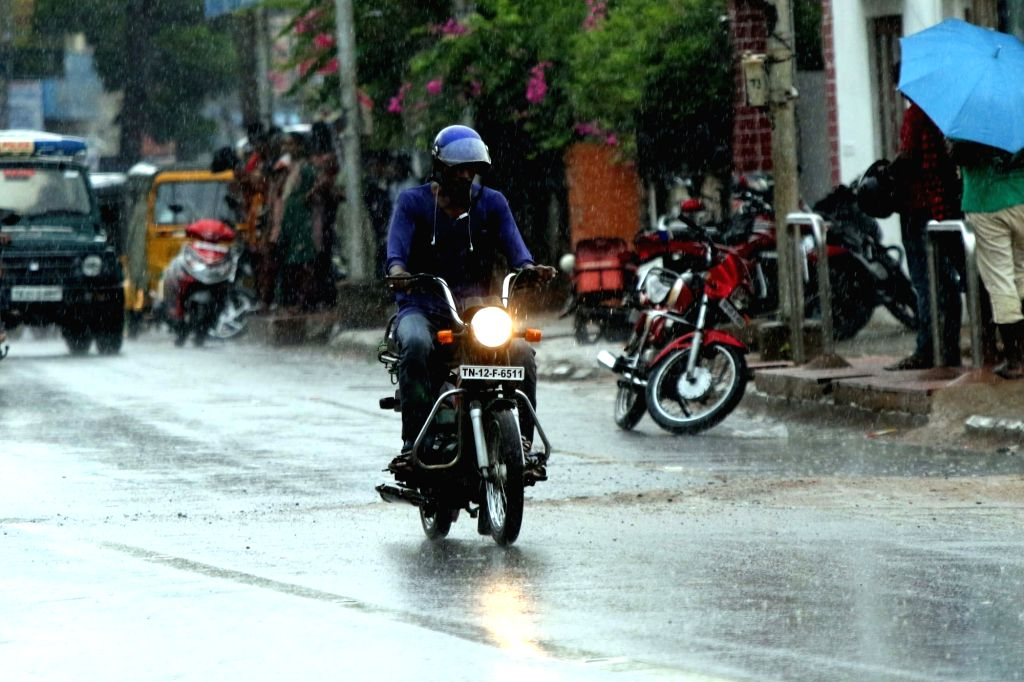 Commuters during rains, in Chennai on June 6, 2018.