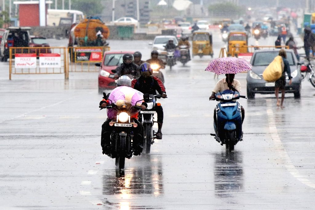 Commuters during rains in Chennai on Oct 17, 2019.