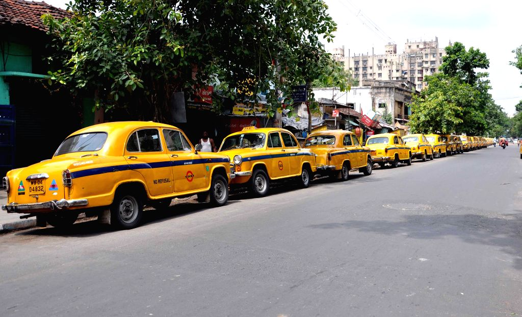 Commuters in Kolkata had a harrying time for the second day at a stretch on Tuesday as yellow taxis went off the road, joining the online cabs which had called a 48-hour strike to press for a host of demands. (Photo: Kuntal Chakrabarty/IANS)