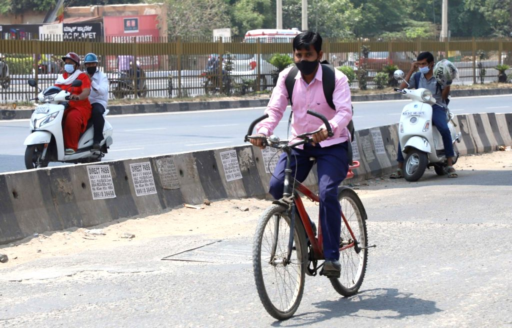 Commuters standard at Airport road during a strike by KSRTC and BMTC employees, in Bengaluru on Saturday 10th April 2021.(photo: Dhananjay Yadav/IANS) - Dhananjay Yadav