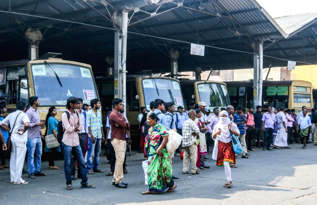 Commuters stranded at a bus depot as transport workers unions began an indefinite strike pressing for higher wages in Chennai on May 15, 2017.  The transport workers went on strike after four rounds ...