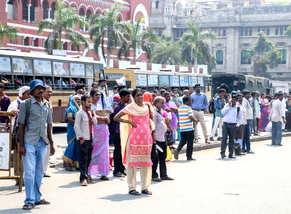 Commuters stranded at a bus stop as transport workers unions began an indefinite strike pressing for higher wages in Chennai on May 15, 2017. The transport workers went on strike after four rounds of ...