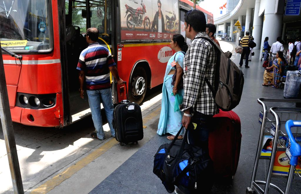 Commuters take bus as taxi drivers go on strike in Kolkata on Aug 11, 2014.