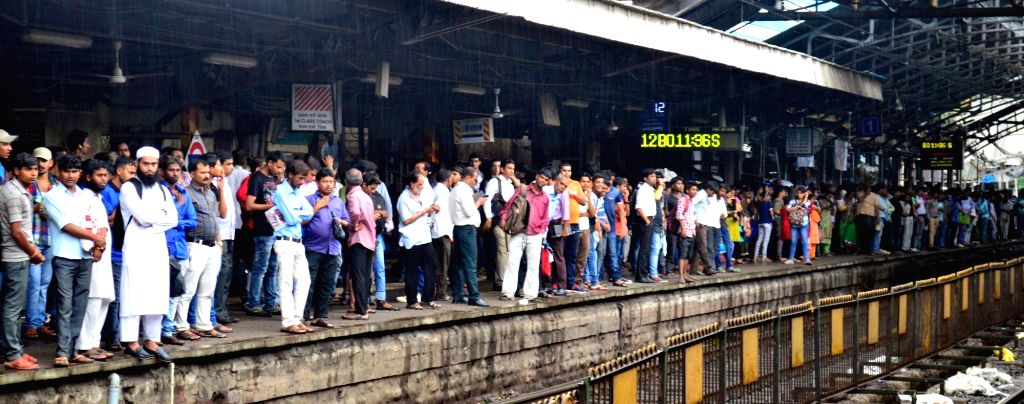 Commuters were stranded at a Mumbai Railway Junction after a major power failure hit Western Railway's suburban services following the theft of a battery box on June 20, 2016.