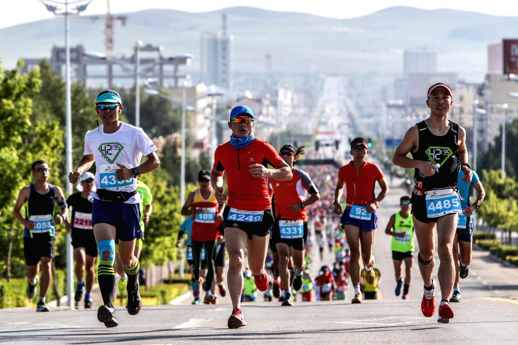 Competitors run during the 9th Grassland Extreme Marathon in West Ujimqin Banner in north China's Inner Mongolia Autonomous Region, July 2, 2016. More ...