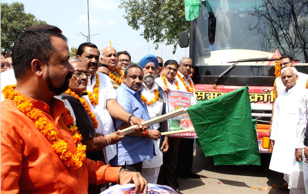 Confederation Of All India Traders (CAIT) Secretary General Praveen Khandelwal flags off 'Sampoorn Kranti Yatra' against the Walmart-Flipkart deal; in New Delhi on Sept 15, 2018. On August ...