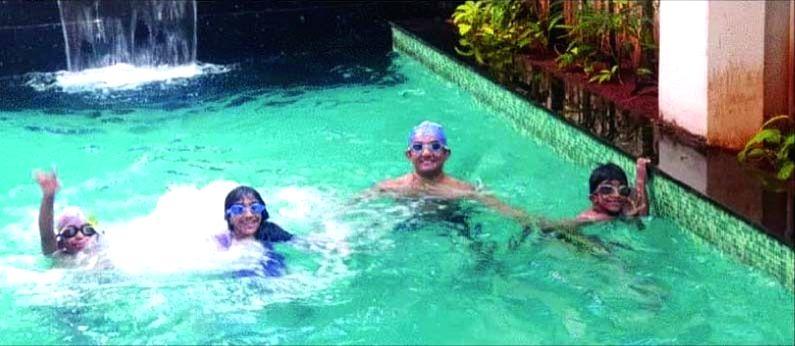 Cong seeks K'taka minister's sack for 'swimming' amid lockdown.
