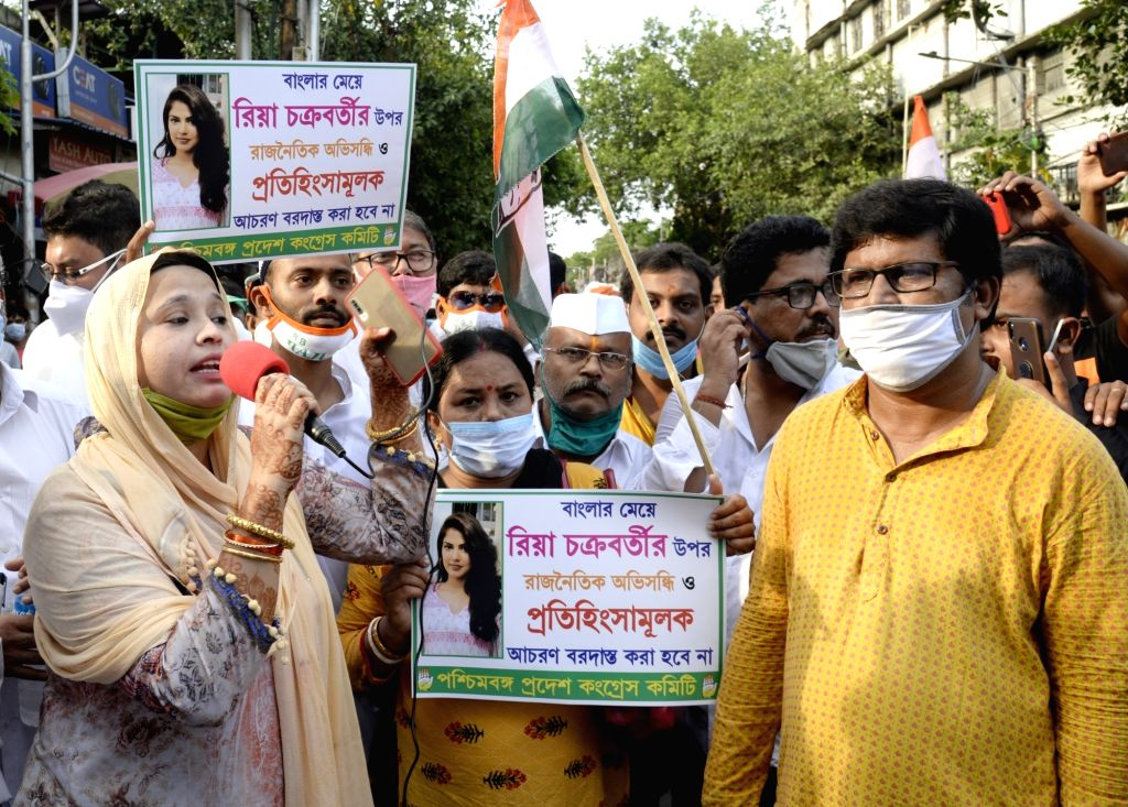 Congress activists protest against the arrest of actress Rhea Chakraborty, in Kolkata on Sep 12, 2020. - Rhea Chakraborty