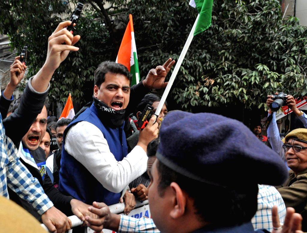 Congress activists protest against the BJP, in Kolkata on Feb 5, 2020.