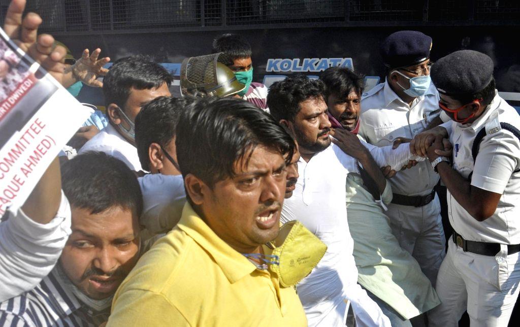 Congress activists stage a demonstration against hike in the prices of petrol and diesel, in Kolkata on July 2, 2020.