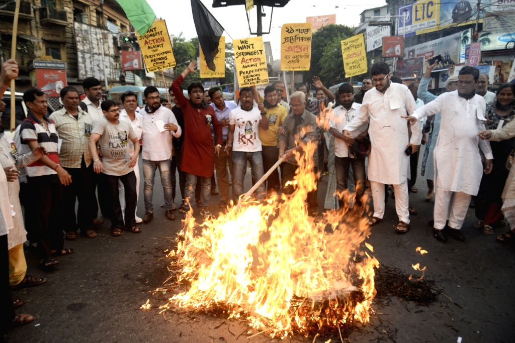 Congress activists stage a demonstration against Assam Chief Minister Sarbananda Sonowal over the killing of five people by militants in Kherbari of Assam's Tinsukia district; in Kolkata on ... - Sarbananda Sonowal
