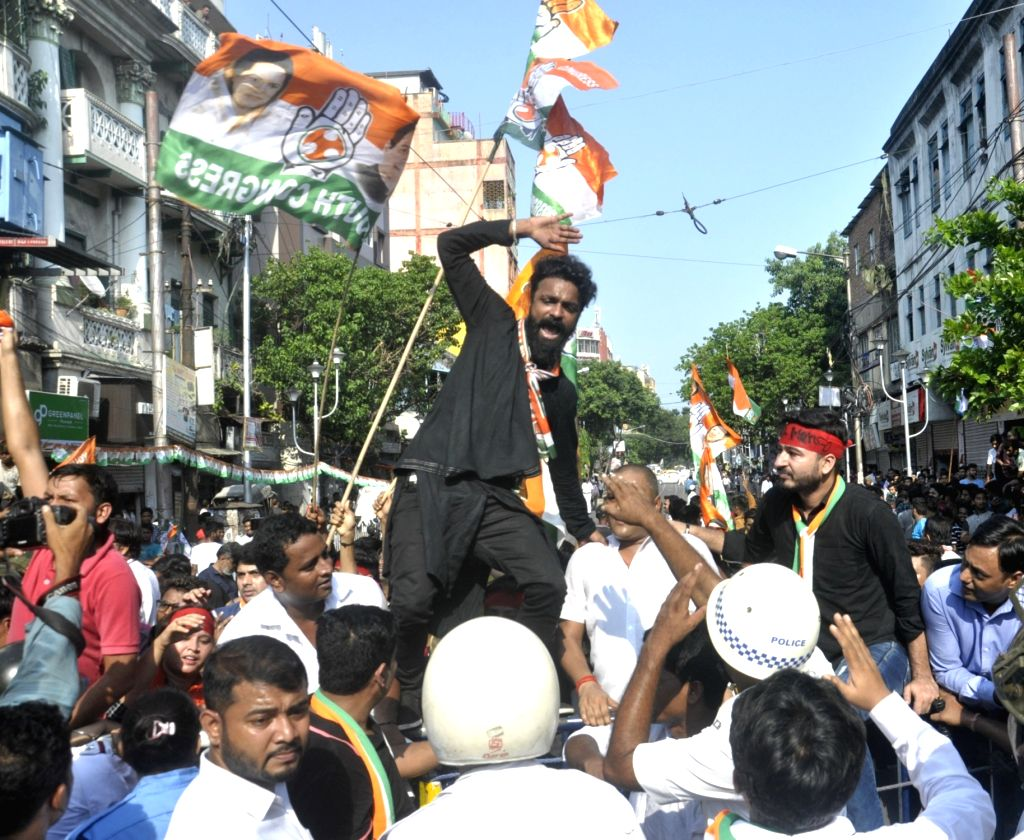 Congress activists stage a demonstration against the Trinamool Congress-led state government over 'cut money', outside Lal Bazar Police headquarters in Kolkata on July 17, 2019.
