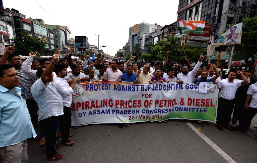 Congress activists stage a demonstration to protest against hike in the prices of petrol and diesel, in Guwahati on May 22, 2018.