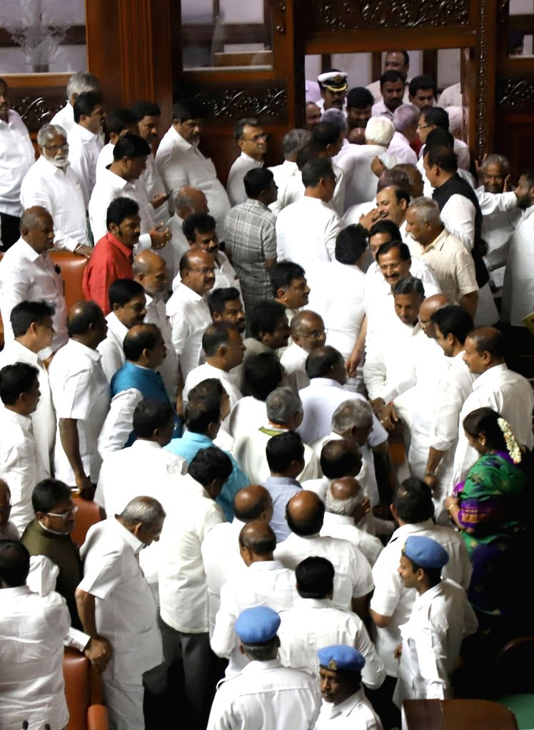 Congress and JD(S) legislators after the trust vote in Karnataka Assembly, in Bengaluru on May 25, 2018. The Karnataka government led by Chief Minister H.D. Kumaraswamy on Friday won the ... - H.