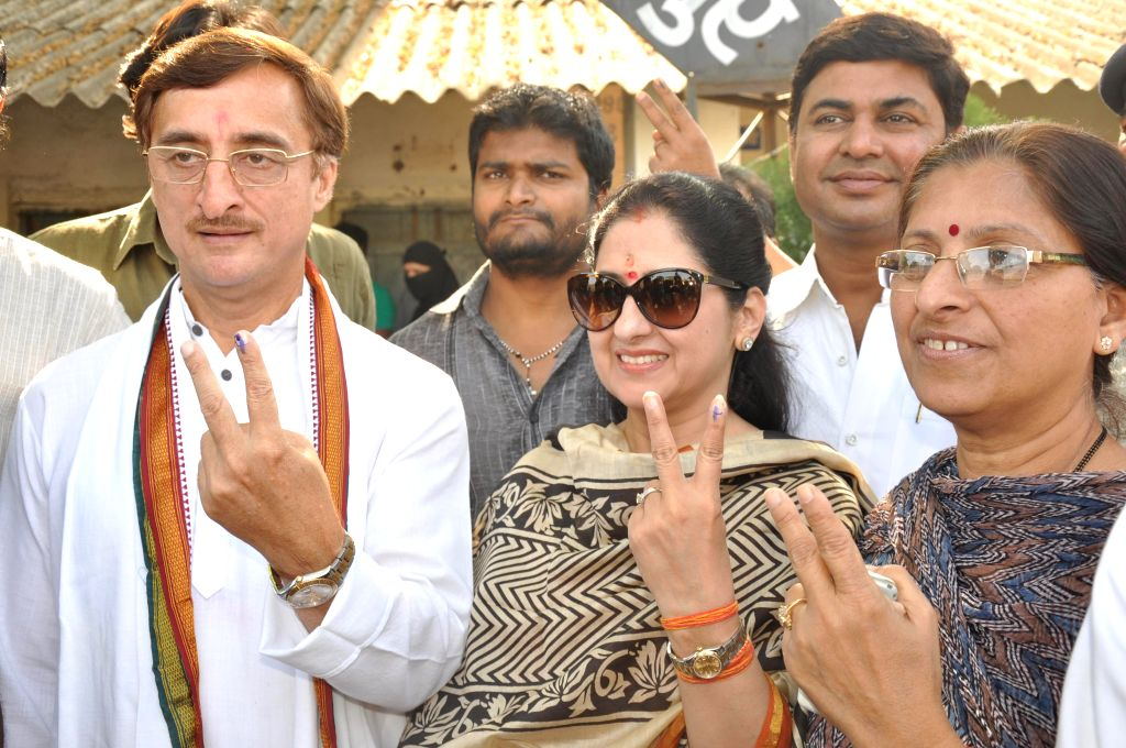 Congress candidate for 2014 Lok Sabha Election from Jabalpur, Vivek Tankha shows his fore finger marked with phosphoric ink after casting his vote during the third phase of 2014 Lok Sabha Polls in ...
