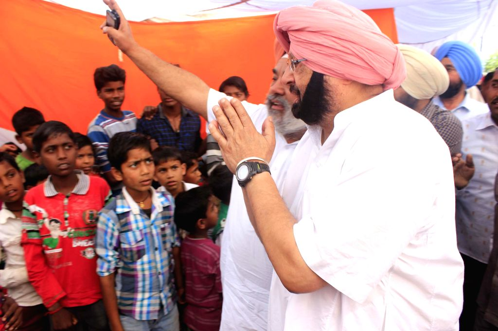 Congress candidate for 2014 Lok Sabha Election from Amritsar, Captain Amarinder Singh during an election campaign in Majitha near Amritsar on April 20, 2014.